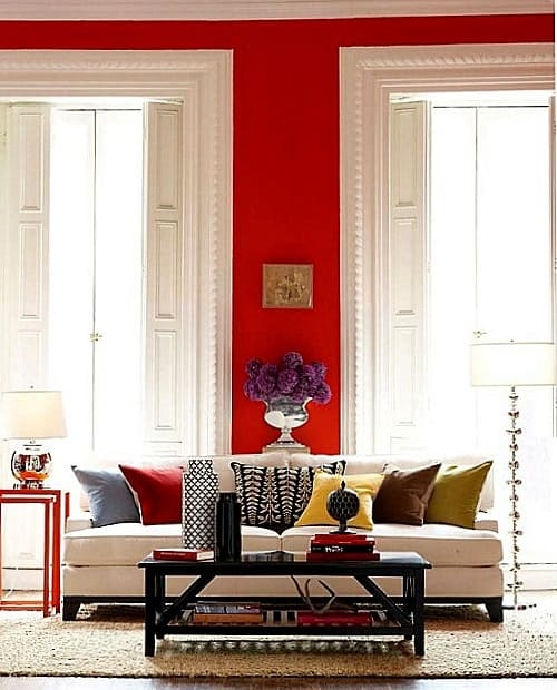 red wall, white sofa