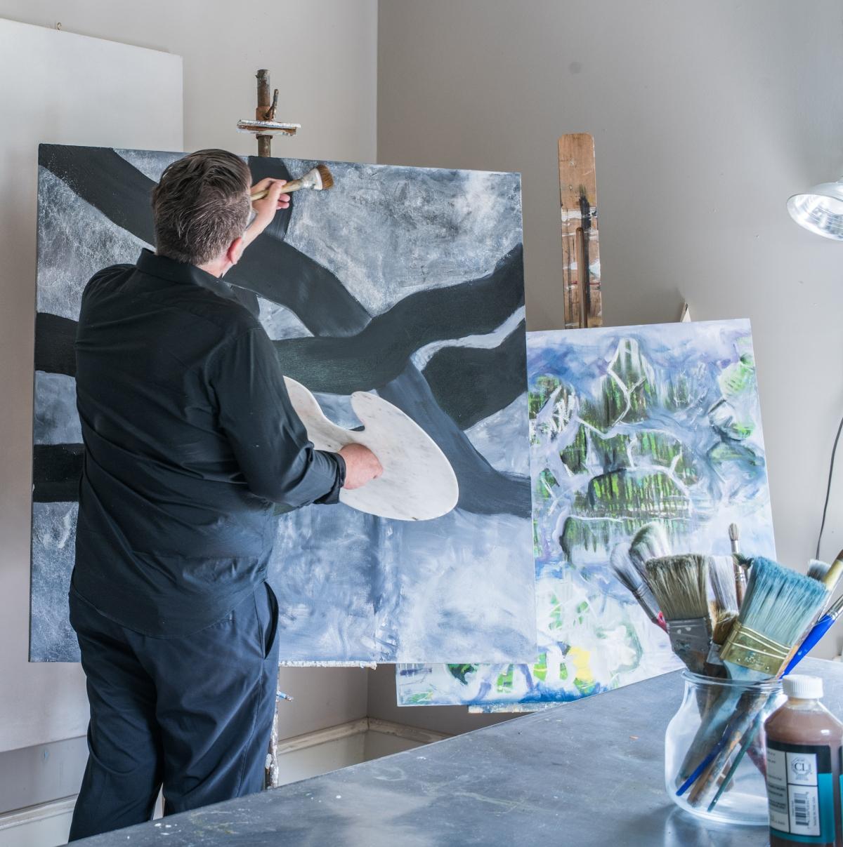 Artist and Designer John Ishmael in his Home Studio