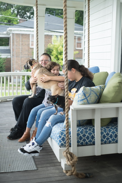 Family and Dog on Porch Swing: The Art of Outdoor Entertaining